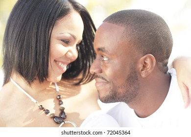 Two young lovers smiling at each other