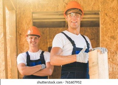 Two young man building wooden house. Ecology concept.