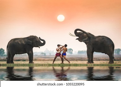 Two young men in ancient fighter uniforms are fighting each other and the elephant.
