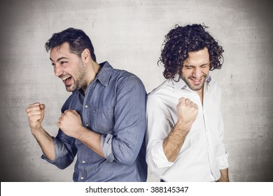 Two young men exult in a expression of victory