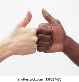Two young men giving each other the thumbs up sign