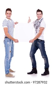 two young men holding a blank board on white background