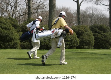 two young men playing golf