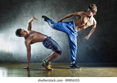Two young men sports fighting on wall background.