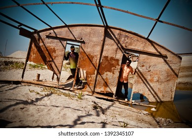 Two young men standing in an abandoned place