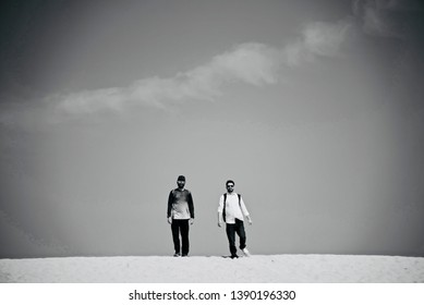 Two young men walking around a coastal area unique photo