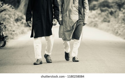 Two young men walking in the street wearing stylish punjabi dress unique photo