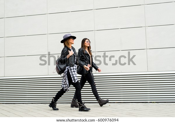 Two young modern girls on the street