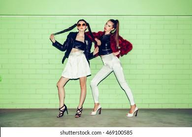 Two young naughty fashion girls having fun