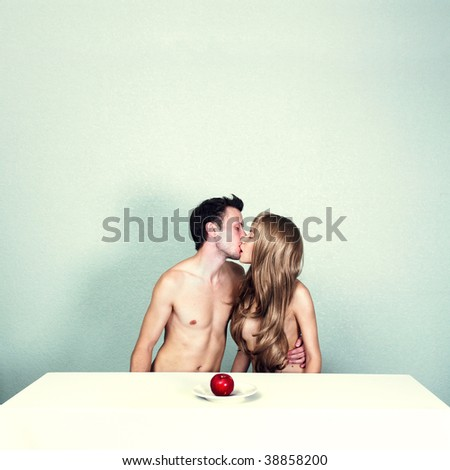 Two young nude lovers with red apple