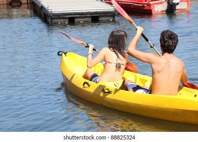 two young people doing canoe