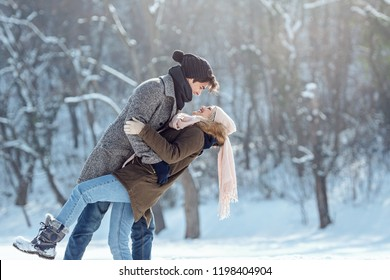 Two young people enjoying in the snow