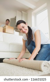 Two young people moving into the house and furnishing the living room