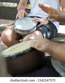 Two young people   playing  tomtom (darbuka)