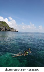 Two young people snorkelling in Ang Thong Marine Park in Thailand.