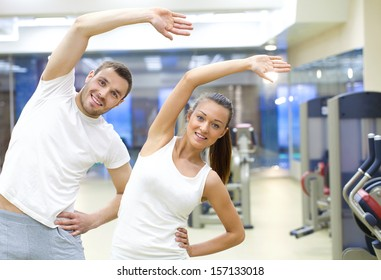 two young people training in gym