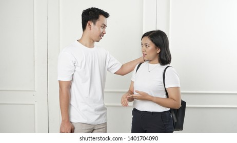 Two young positive asian studens are discussing their university project. Couple are talking about their university report they did