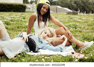 two young pretty teenager girls best friends laying on grass making selfie photo having fun, lifestyle happy people concept, students at summer