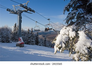 Two young skiers on a lift chair