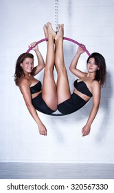 Two young slim sports women on ring.