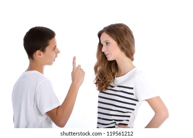 Two young teenagers arguing with the boy wagging his finger at his sister in a dogmatic manner, upper body studio portrait on white