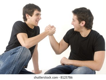 Two young teenagers having fun on white background