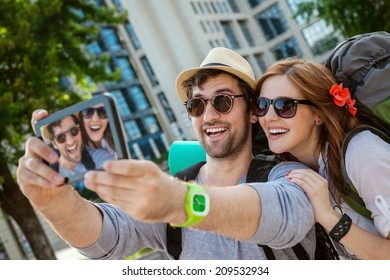 Two Young Tourists Taking Selfie Using Digital Tablet