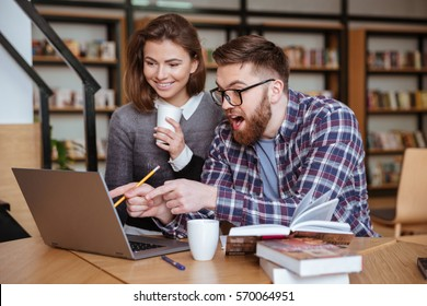 Two young university students studying in library