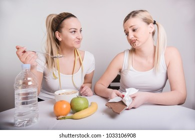 two young woman discusing about healthy meal