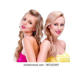 Two young woman friends portrait isolated on white background