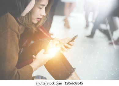 two young woman sitting are play smartphone with line network,business technology concept