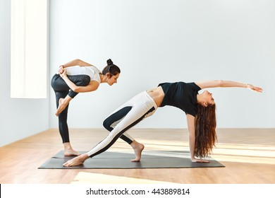 Two young women dancing in gym