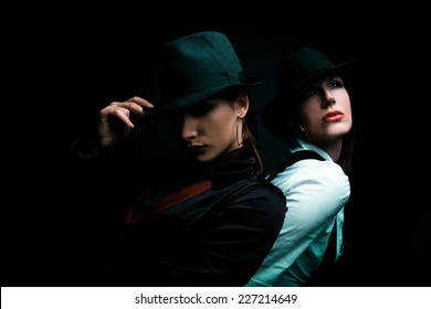 Two young women dressed like detectives