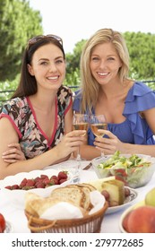 Two Young Women Enjoying Outdoor Meal Together