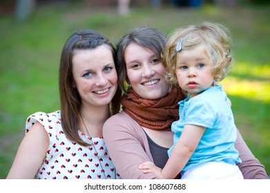 two young women with little girl