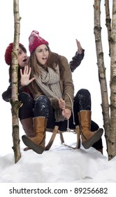 two young women on a sledge