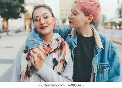 two young women outdoors posing hugging - best friends, bonding, interaction concept