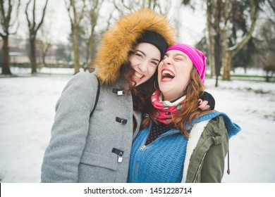 two young women posing for photo and smiling– joyful, vacation, communication