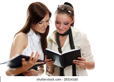 two young women reading book