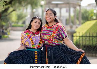 Two young women show their beautiful typical dress from Quetzaltenango Guatemala.