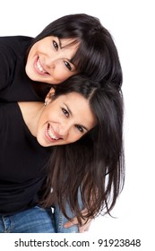 Two young women smiling and piggyback