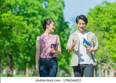 Two youths walking while talking