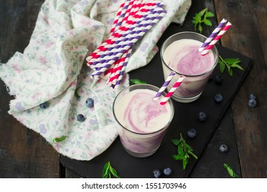 Two-colored fruit smoothie, in a glass, in a dark background