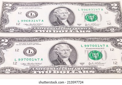 Two-dollar bills. On a white background in the closeup