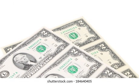 Two-dollar bills. There is white space for text. Whole background.