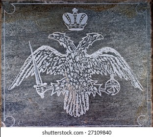 Two-headed eagle carved in stone.