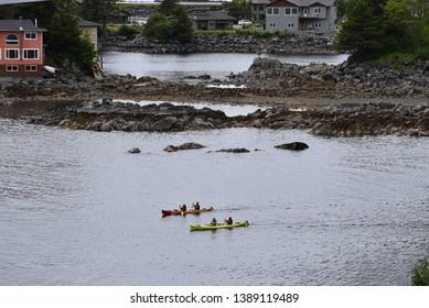 Two-man kayaks on the Sitka River in Alaska