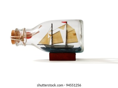 Two-masted ship in a bottle isolated on white background