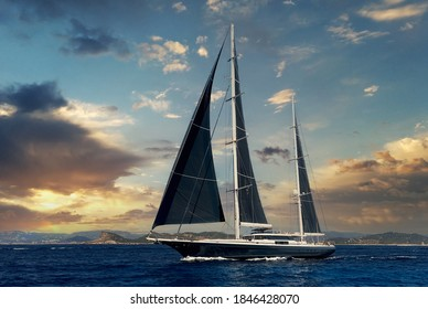 Two-masted yacht in the Mediterranean sea during bright majestic sunset. Ibiza, Balearic Islands. Europe, Spain