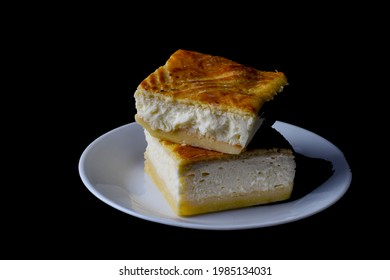 tworicotta cheese squres stack on each other against a black background